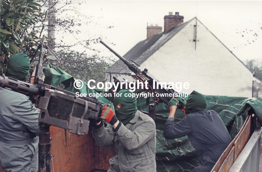 This republican movement press release photograph claims to be of a Provisional IRA border unit on manoeuvres in Co Fermanagh, N Ireland, February 1977.  The volunteers are using a 50 mm Browning M2 machine guns. 197702130024g<br /> <br /> Copyright Image distributed by Victor Patterson, 54 Dorchester Park, Belfast, UK, BT9 6RJ<br /> <br /> Tel: +44 28 9066 1296<br /> Mob: +44 7802 353836<br /> Voicemail +44 20 8816 7153<br /> Email: victorpatterson@me.com<br /> <br /> <br /> IMPORTANT: If you wish to use this image or any other of my images please go to www.victorpatterson.com and click on the Terms &amp; Conditions. Then contact me by email or phone with the reference number(s) of the image(s) concerned.
