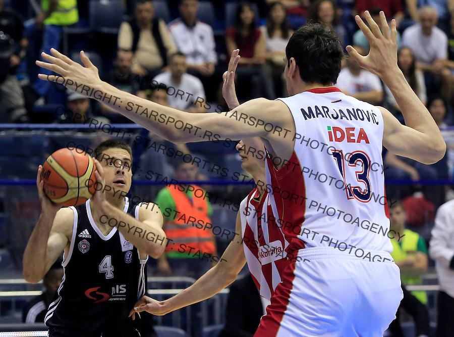 Kosarka Kosarkaska Liga Srbije season 2014-2015<br /> Crvena Zvezda v Partizan<br /> Milenko Tepic (L) Boban Marjanovic and Nemanja Dangubic<br /> Belgrade, 05.17.2015.<br /> foto: Srdjan Stevanovic/Starsportphoto &copy;