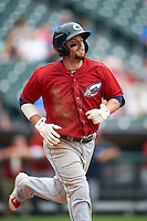 Columbus Clippers outfielder Tyler Holt (15) runs to first during a game against the Buffalo Bisons on July 19, 2015 at Coca-Cola Field in Buffalo, New York.  Buffalo defeated Columbus 4-3 in twelve innings.  (Mike Janes/Four Seam Images)