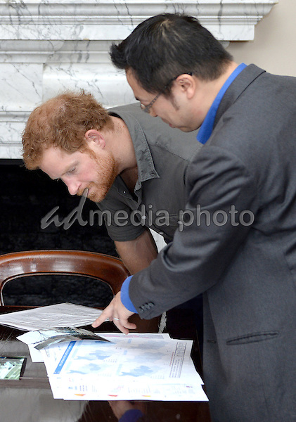 16 March 2016 - London, England - Prince Harry speaks with MapAction during a briefing by MapAction to learn more about the charity's response to the recent Nepal earthquakes, ahead of his tour to the country later this month. Photo Credit: Alpha Press/AdMedia