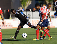 Simon Dawkins of Earthquakes dribbles the ball away from Chivas defenders during the game at Buck Shaw Stadium in Santa Clara, California on September 2nd, 2012.   San Jose Earthquakes defeated Chivas USA, 4-0.