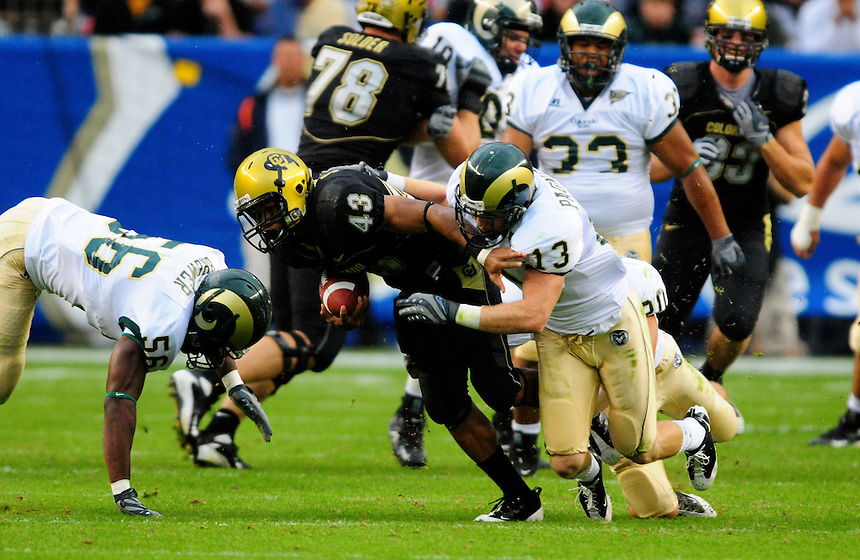 31 Aug 2008: Colorado tailback Rodney Stewart (43) is tackled by Colorado State safety Mike Pagnotta. The Colorado Buffaloes defeated the Colorado State Rams 38-17 at Invesco Field at Mile High in Denver, Colorado. FOR EDITORIAL USE ONLY