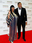 Aretha Franklin and Richard Gibbs arrive for the formal Artist's Dinner honoring the recipients of the 2012 Kennedy Center Honors hosted by United States Secretary of State Hillary Rodham Clinton at the U.S. Department of State in Washington, D.C. on Saturday, December 1, 2012. The 2012 honorees are Buddy Guy, actor Dustin Hoffman, late-night host David Letterman, dancer Natalia Makarova, and the British rock band Led Zeppelin (Robert Plant, Jimmy Page, and John Paul Jones)..Credit: Ron Sachs / CNP