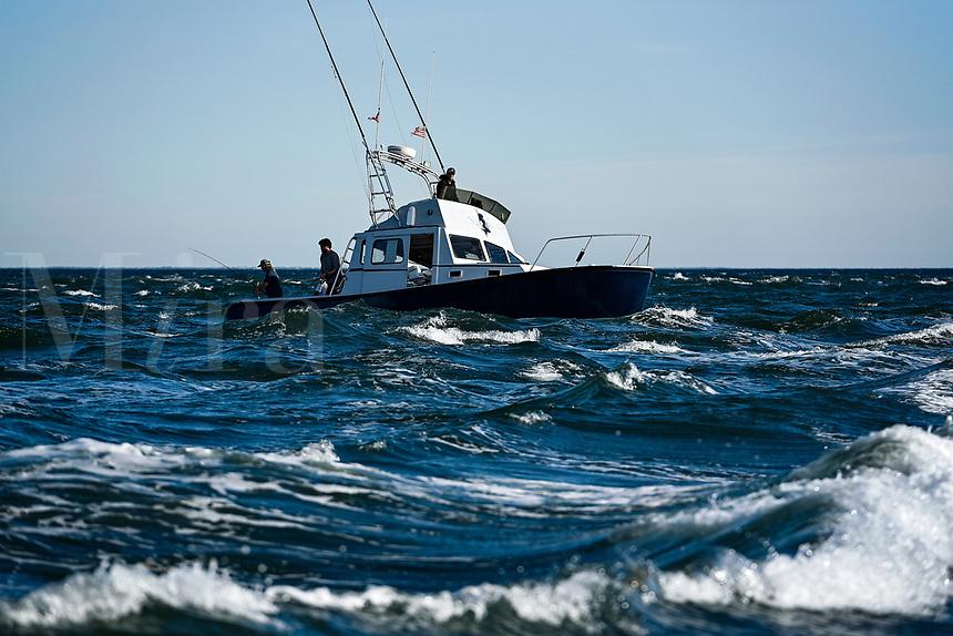 Charter fishing boat on rough sea, Cape Cod, Massachusetts, USA.