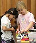 Christy Brase, 9, left, and Katie Jeffries, 10 play at the Lego Club event at the Carson City Library, in Carson City, Nev., on Saturday, Dec. 17, 2011. .Photo by Cathleen Allison