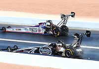 Mar 30, 2014; Las Vegas, NV, USA; NHRA top fuel driver Shawn Langdon (near lane) alongside Antron Brown during the Summitracing.com Nationals at The Strip at Las Vegas Motor Speedway. Mandatory Credit: Mark J. Rebilas-