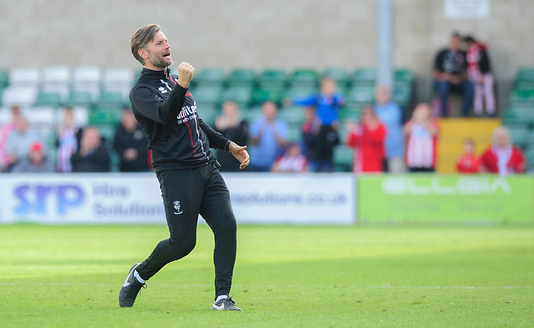 Lincoln City's assistant manager Nicky Cowley celebrates at the end of the game<br /> <br /> Photographer Chris Vaughan/CameraSport<br /> <br /> The EFL Sky Bet League One - Lincoln City v Fleetwood Town - Saturday 31st August 2019 - Sincil Bank - Lincoln<br /> <br /> World Copyright © 2019 CameraSport. All rights reserved. 43 Linden Ave. Countesthorpe. Leicester. England. LE8 5PG - Tel: +44 (0) 116 277 4147 - admin@camerasport.com - www.camerasport.com