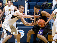 David Kravish of California tries to steal the ball away from Abdul Gaddy of Washington during the game at Haas Pavilion in Berkeley, California on January 9th, 2013.   Washington defeated California, 62-47.