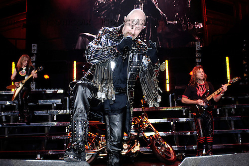Judas Priest - L-R: KK Downing, Rob Halford, Glenn Tipton - performing live in concert at the benefit for the Teenage Cancer Trust held at the Royal Albert Hall in London UK - 31 March 2006.  Photo credit: George Chin/IconicPix