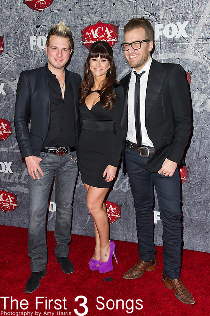 Mike Gossin, Rachel Reinert, and Tom Gossin arrives at the American Country Awards 2012 at the Mandalay Bay Resort & Casion in Las Vegas, Nevada
