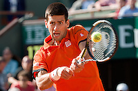 June 3, 2015: Novak Djokovic of Serbia in action in a Quarterfinal match against Rafael Nadal of Spain on day eleven of the 2015 French Open tennis tournament at Roland Garros in Paris, France. Djokovic won 75 63 61. Sydney Low/AsteriskImages