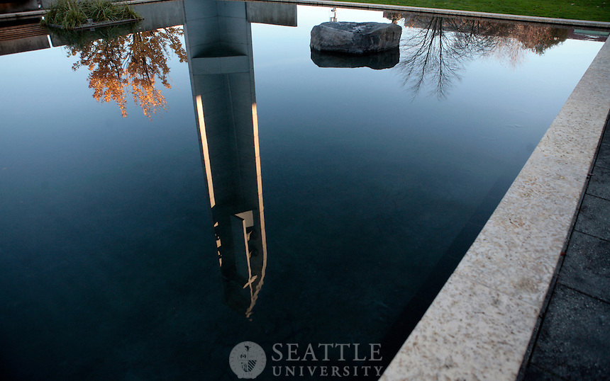 11032010- A reflection of the bell tower is seen in the water of Seattle University's Reflection Pool that sits in front of the Chapel of St. Ignatius.