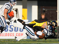 Jul 7, 2007; Hamilton, ON, CAN; Toronto Argonauts quarterback (17) Michael Bishop is sacked by Hamilton Tiger-Cats defensive end (9) Nautyn McKay-Loescher during the first half of the 2007 season home opener at Ivor Wynne Stadium. The Argos defeated the Tiger-Cats 30-5. Mandatory Credit: Ron Scheffler, Special to the Spectator.