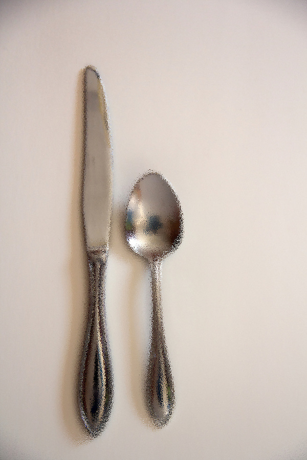 Diner setting butter knife and spoon on white background filtered image