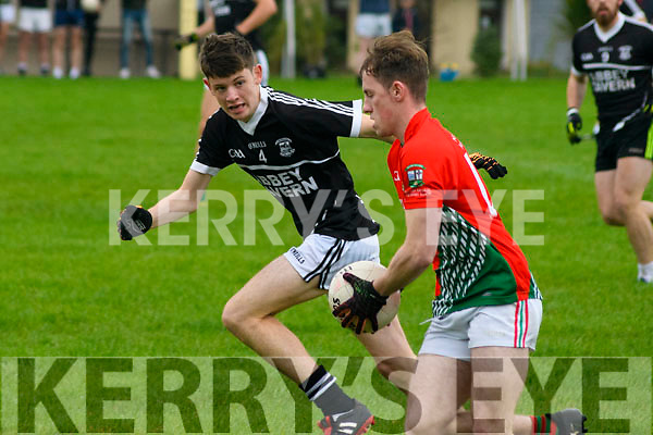 Barry O'Connell of St. Michaels-Foilmore being tracked by Philip Mc Carthy of Ardfert in The Barrett Cup Junior Final