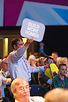 © Joel Goodman - 07973 332324 . 22/09/2013 . Brighton , UK . A man in the audience holds up a sign that reads BUILD MORE HOMES during a session this afternoon (Sunday 22nd September 2013) . Day 1 of the Labour Party 's annual conference in Brighton . Photo credit : Joel Goodman