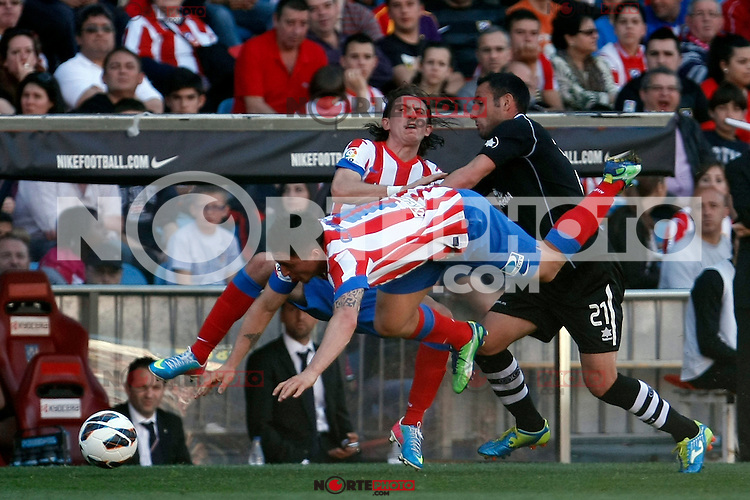 Atletico's Filipe Luis and C.Rodriguez (d) and Granada's Juanma Ortiz during La Liga BBVA match. April 14, 2013.(ALTERPHOTOS/Alconada)