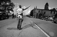2013 Giro d'Italia.stage 13: Busseto - Cherasco ..peloton approaching carer Gert Van Dommelen (BEL) in the feedzone