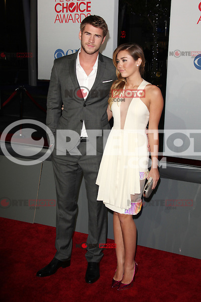 Liam Hemsworth and Miley Cyrus at the 2012 People's Choice Awards held at Nokia Theatre L.A. Live on January 11, 2012 in Los Angeles, California. © mpi26/Mediapunch Inc.