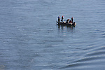 Fishermen in a boat on Lake Taneycomo below the Table Rock Dam