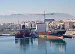 Cargo ships in the port of Malaga, Spain