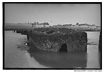 Remains of port Mulberry, Artificial harbour imported by British army, Arromanches, Normandy, France May 1994