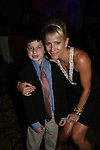 Kelley Menighan Hensley poses with Ben - received help from Angels for Hope and attended the benefit Angels for Hope which benefits St. Jude Children's Research Hospital on May 29, 2009 at the Estate at Florentine Gardens, Rivervale, NJ. (Photo by Sue Coflin/Max Photos)