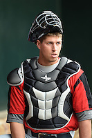 New Britain Rock Cats catcher Kyle Knudson (26) in the dugout during practice before a game against the Harrisburg Senators on April 28, 2014 at Metro Bank Park in Harrisburg, Pennsylvania.  Harrisburg defeated New Britain 9-0.  (Mike Janes/Four Seam Images)
