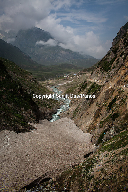 An overview the melting glaciers in Zojibal, where Hindu pilgrims walk along the Amarnath trekking route in Kashmir, India. Hindu pilgrims brave sub zero temperature and high latitude passes and make their pilgrimage to reach the sacred Amarnath cave, which houses a lingam - a stylized phallus, worshiped by Hindus as a symbol of God Shiva. Photo: Sanjit Das/Panos