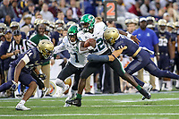 Annapolis, MD - October 26, 2019: Tulane Green Wave running back Tyjae Spears (22) gets tackled by Navy Midshipmen safety Evan Fochtman (11) during the game between Tulane and Navy at  Navy-Marine Corps Memorial Stadium in Annapolis, MD.   (Photo by Elliott Brown/Media Images International)
