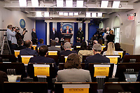 United States President Donald J. Trump speaks during a press briefing on the Coronavirus COVID-19 pandemic with members of the Coronavirus Task Force at the White House in Washington on March 19, 2020.  Standing behind the President, from left to right: United States Vice President Mike Pence; Stephen Hahn, Commissioner, United States Food and Drug Administration (FDA); Dr. Deborah L. Birx, White House Coronavirus Response Coordinator; and United States Surgeon General Vice Admiral (VADM) Jerome M. Adams, M.D., M.P.H. <br /> Credit: Yuri Gripas / Pool via CNP/AdMedia