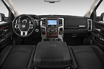 Stock photo of straight dashboard view of a 2015 Ram 2500 Laramie Mega Cab 4 Door Truck Dashboard