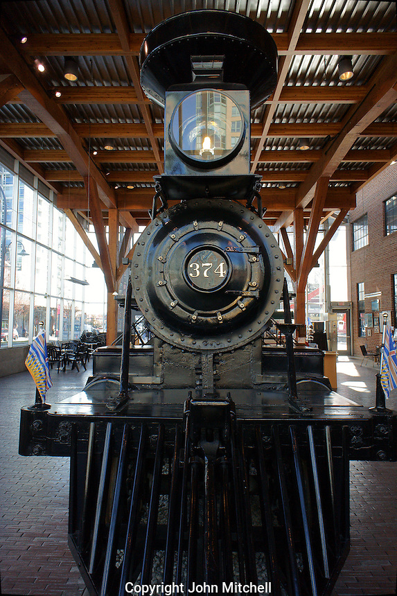 Restored CPR Engine 374 at the Roundhouse  in Yaletown, Vancouver, British Columbia, Canada. On May 23, 1887 this steam engine pulled the first transcontinental train into Vancouver.