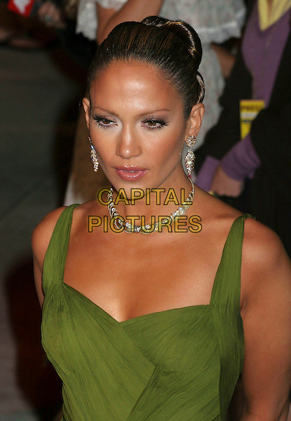 JENNIFER LOPEZ.2006 Vanity Fair Oscar Party held at Morton's, West Hollywood, California, USA, 05 March 2006..oscars half length green dress.Ref: ADM/RE.www.capitalpictures.com.sales@capitalpictures.com.©Russ Elliot/AdMedia/Capital Pictures.