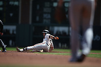 SAN FRANCISCO, CA - APRIL 8:  Evan Longoria #10 of the San Francisco Giants slides into second base against the Los Angeles Dodgers during the game at AT&T Park on Sunday, April 8, 2018 in San Francisco, California. (Photo by Brad Mangin)
