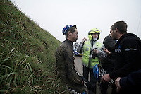 Dwars Door Vlaanderen 2013.Jack Bauer (NZL) dazed by the roadside after crashing hard on the Ladeuze descent