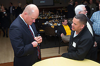 "Former Major League Baseball pitcher Jim Abbott (left) autographs a baseball for Juan Soto at the Wake Forest Baseball ""First Pitch"" Dinner on February 9, 2017 in Winston-Salem, North Carolina.  (Brian Westerholt/Four Seam Images)"