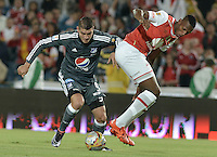 BOGOTÁ -COLOMBIA, 07-02-2016. Yerry Mina (Der.) jugador de Santa Fe disputa el balón con Michael Rangel (Izq.) jugador de Millonarios durante partido entre Independiente Santa Fe y Millonarios por la fecha 3 de la Liga Aguila I 2016  jugado en el estadio Nemesio Camacho El Campin de la ciudad de Bogota. / Yerry Mina (R) player of Santa Fe struggles for the ball with Michael Rangel (L) player of Millonarios during a match between Independiente Santa Fe and Cucuta Deportivo for the date 3 of the Liga Aguila I 2016 played at the Nemesio Camacho El Campin Stadium in Bogota city. Photo: VizzorImage/ Gabriel Aponte / Staff