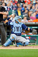 Tampa Bay Rays catcher Jose Molina (28) throws the ball back to his pitcher during the Major League Baseball game against the Detroit Tigers at Comerica Park on June 4, 2013 in Detroit, Michigan.  The Tigers defeated the Rays 10-1.  Brian Westerholt/Four Seam Images