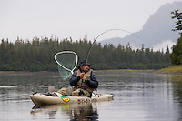 Kayak fishing for Silver salmon (Coho) in the Valdez, Alaska area of south central Alaska with Pacific Mountain Guides outfitter Otto Kulm. Fishing was done in both salt water and fresh water in the Prince William Sound region.  Otto Kulm fly fishing for Coho at Irish Cove.