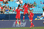 15 July 2015: Maykel Alejandro Reyes (CUB) (9) and Yaisnier Napoles (CUB) (6) challenge for a header with Deniss Lopez (GUA) (behind, in white). The Cuba Men's National Team played the Guatemala Men's National Team at Bank of America Stadium in Charlotte, NC in a 2015 CONCACAF Gold Cup Group C match.