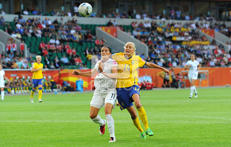 Alex Krieger (l) of team USA and Josefine Oqvist of team Sweden during the FIFA Women's World Cup at the FIFA Stadium in Wolfsburg, Germany on July 6thd, 2011.
