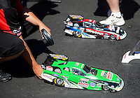 Apr. 13, 2012; Concord, NC, USA: Radio controlled replicas of the NHRA funny cars of John Force (near) and Courtney Force on the vendors midway during qualifying for the Four Wide Nationals at zMax Dragway. Mandatory Credit: Mark J. Rebilas-