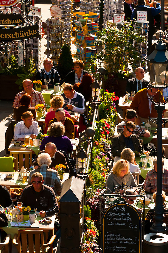 People at outdoor cafes on Munzgasse in the Altstadt (old city), Dresden, Saxony, Germany