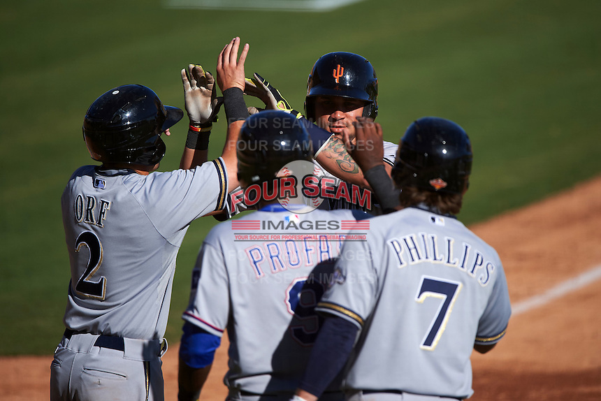 Surprise Saguaros catcher Gary Sanchez (78) high fives teammates Nate Orf (2), Jurickson Profar (9) and Brett Phillips (7) after hitting a home run during an Arizona Fall League game against the Glendale Desert Dogs on October 24, 2015 at Camelback Ranch in Glendale, Arizona.  Surprise defeated Glendale 18-3.  (Mike Janes/Four Seam Images)