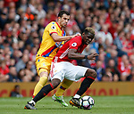 Luka Milivojevic of Crystal Palace inaction with Paul Pogba of Manchester United during the English Premier League match at the Old Trafford Stadium, Manchester. Picture date: May 21st 2017. Pic credit should read: Simon Bellis/Sportimage