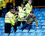 Police encourage a young fan to leave during the Barclays Premier League match at The Etihad Stadium. Photo credit should read: Simon Bellis/Sportimage