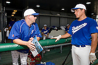 20 August 2007: Coach Joshua Ridgway (left) talks to Boris Marche in the dugout prior to the Czech Republic 6-1 victory over France in the Good Luck Beijing International baseball tournament (olympic test event) at the Wukesong Baseball Field in Beijing, China.