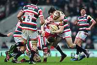 Matt Kvesic of Gloucester Rugby is double-tackled. Aviva Premiership match, between Leicester Tigers and Gloucester Rugby on February 11, 2017 at Welford Road in Leicester, England. Photo by: Patrick Khachfe / JMP