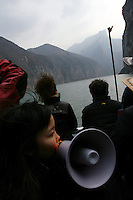 CHINA. Chongqing Province.  Tourists travelling through the 3 Gorges. The flooding of the three Gorges, by damming the Yangtze near the town of YiChang, has remained a controversial subject due to the negative environmental consequences and the displacement of millions of people in the flood plain. The Yangtze River however is reported to be at its lowest level in 150 years as a result of a country-wide drought. It is China's longest river and the third longest in the world. Originating in Tibet, the river flows for 3,964 miles (6,380km) through central China into the East China Sea at Shanghai.  2008.